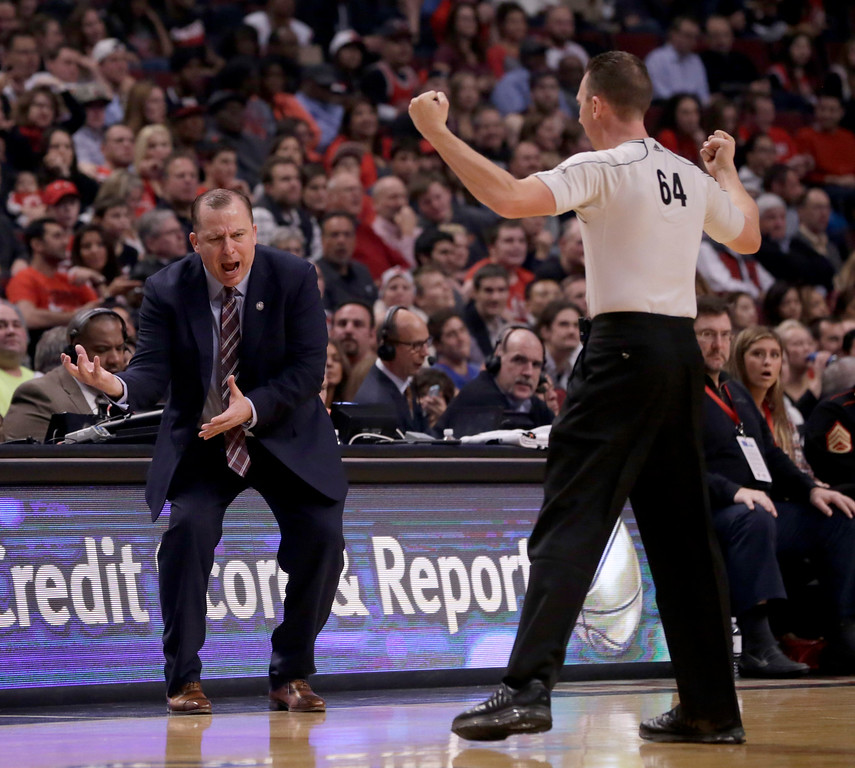 . Chicago Bulls head coach Tom Thibodeau, left, argues a call against his player with referee Justin VanDuyne, during the first half of an NBA basketball game Monday, Nov. 10, 2014, in Chicago. The Bulls won 102-91. (AP Photo/Charles Rex Arbogast)