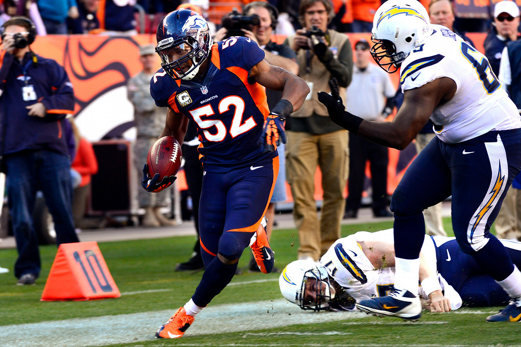 . Woodyard barely steps out of bounds after intercepting the ball and running down the slideline in the first half against the Chargers. (Joe Amon, The Denver Post)