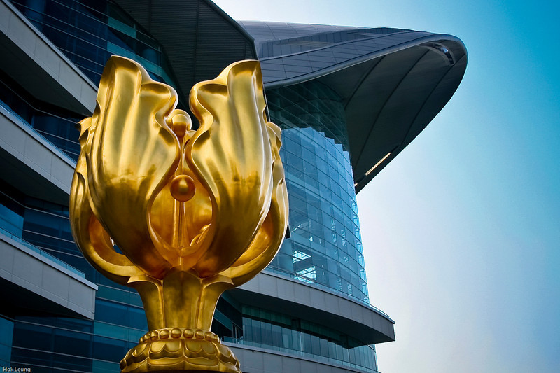 Hong Kong Convention and Exhibition Centre (香港會議展覽中心) or HKCEC (會展).  In front of this beautiful structure is the Golden Bauhinia (金紫荊).