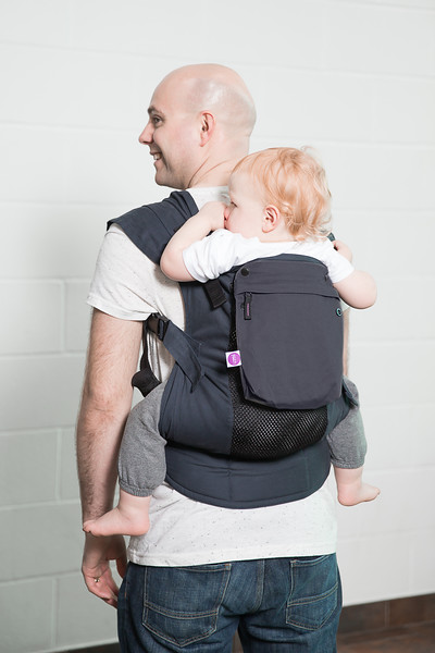 Izmi_Accessories_Lifestyle_Pocket_Midnight_Blue_On_Midnight_Blue_Toddler_Carrier_Dad_Back_Carry.jpg
