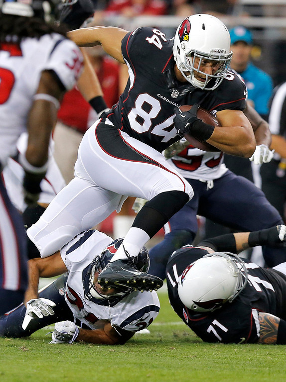 . Arizona Cardinals tight end Rob Housler (84) scores a touchdown against the Houston Texans during the first half of an NFL football game Sunday, Nov. 10, 2013, in Glendale, Ariz. (AP Photo/Ross D. Franklin)