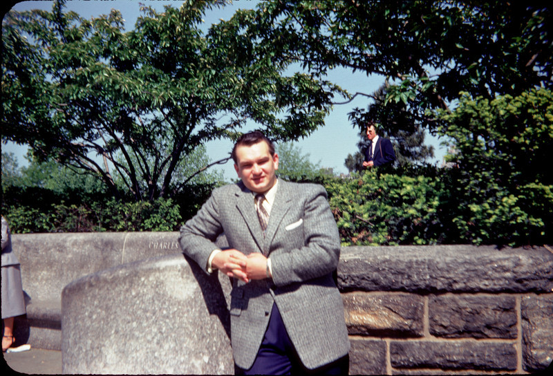 daddy in suit against rock wall.jpg
