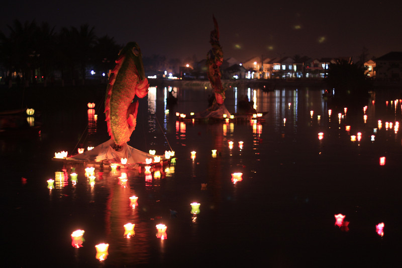 Hoi An's Full Moon Festival brings people out who light candles and send them in small lotus cups down the river.