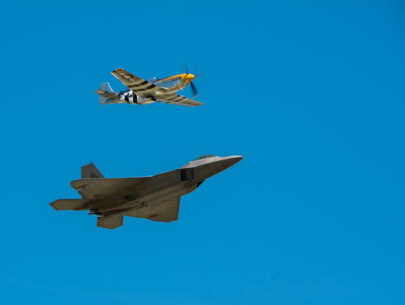 The top fighter planes of their times: Mustang (on top) during WWII and F22.
