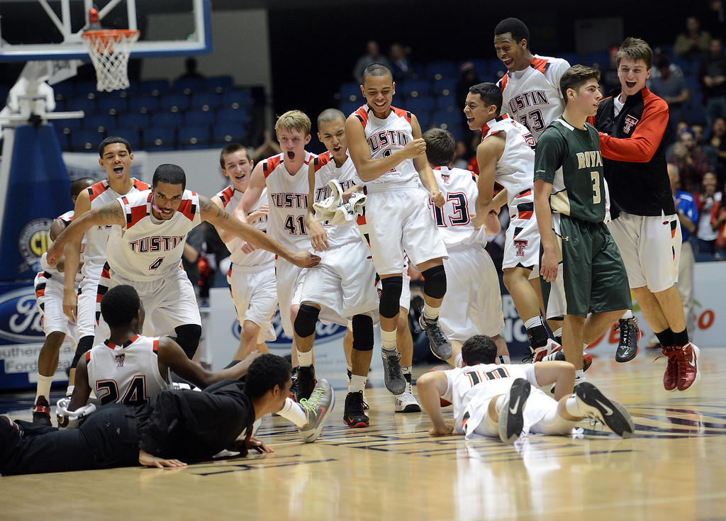 . Tustin players run on to the court as Royal\'s Justin Anderson #3 walks off during their CIF-SS Division III-AAA BoysBasketball Championship at the Anaheim Convention Center Thursday, February 28, 2013. Tustin beat Royal 49-32.  (Hans Gutknecht/Staff Photograpehr)