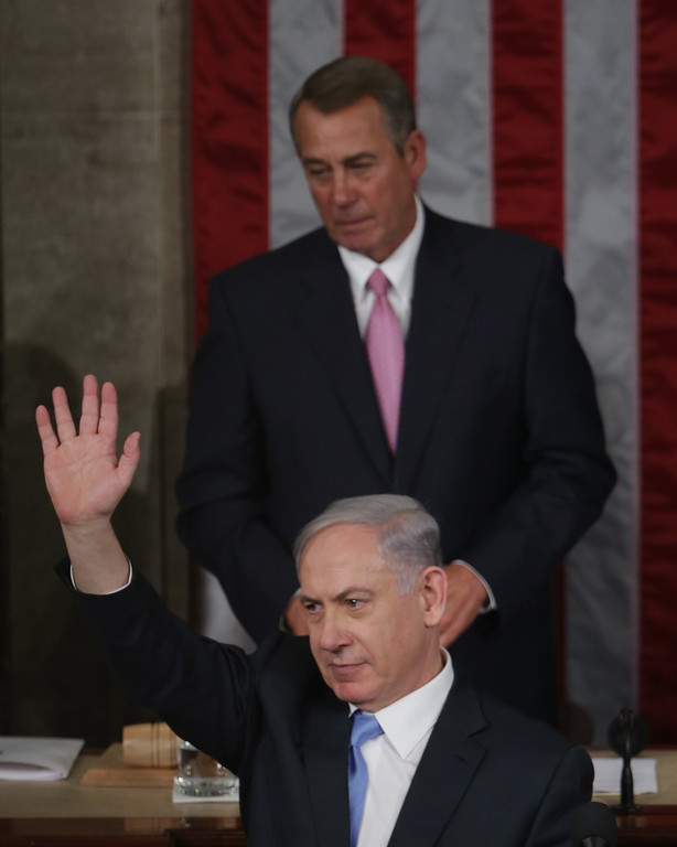 . Israeli Prime Minister Benjamin Netanyahu waves after speaking about Iran during a joint meeting of the United States Congress in the House chamber at the U.S. Capitol March 3, 2015 in Washington, DC. At the risk of further straining the relationship between Israel and the Obama Administration, Netanyahu warned members of Congress against what he considers an ill-advised nuclear deal with Iran. Also pictured are House Speaker John Boehner (R-OH).  (Photo by Alex Wong/Getty Images)
