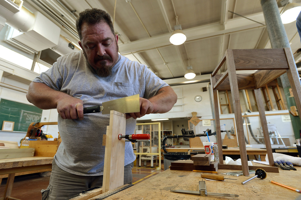 . Jason Deitch hand cuts dovetail joints as he works on a project in Pleasant Hill, Calif. on Wednesday, July 24, 2013. The Diablo Woodworkers are reaching out to military veterans like Deitch and emphasizing the therapeutic qualities of woodworking. (Kristopher Skinner/Bay Area News Group)