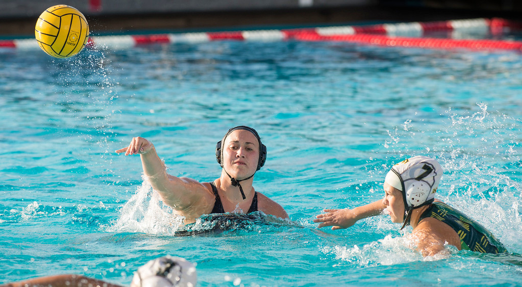 . La Serna High\'s Gabby Pierandozzi passes vs Temple City High in the CIF-SS girls water polo first-round game at Whittier High Feb. 14, 2013.   (SGVN/Staff photo by Leo Jarzomb)