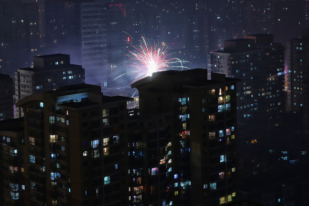 . Fireworks illuminate a residential area to celebrate Chinese Lunar New Year of Horse and cause severe air pollution on January 30, 2014 in Beijing, China.   (Photo by Feng Li/Getty Images)