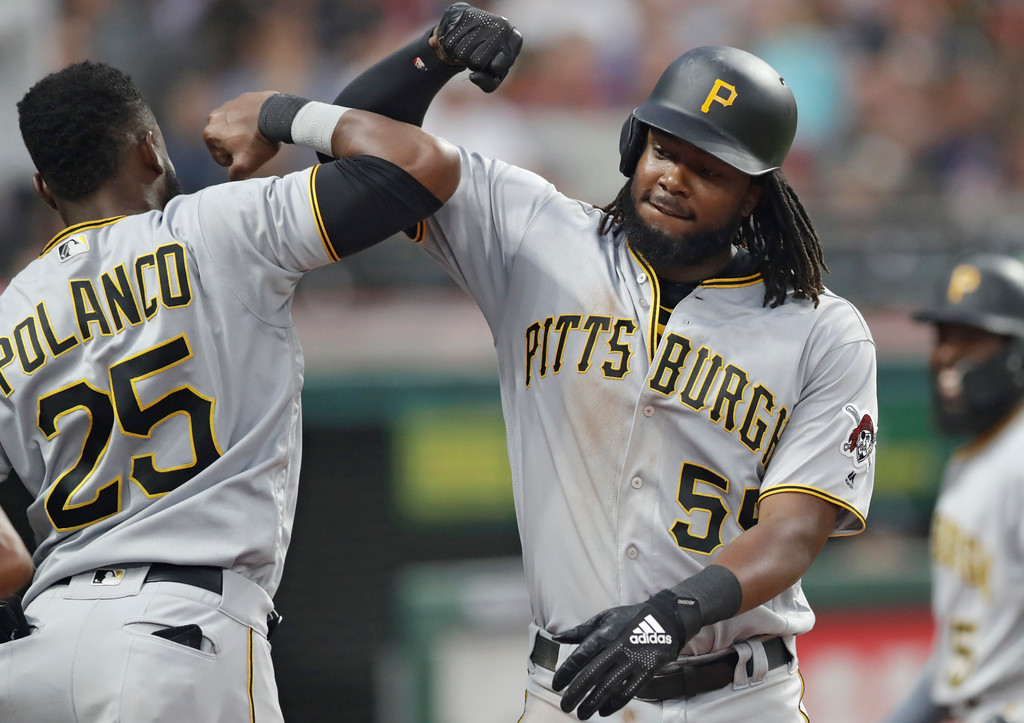 . Pittsburgh Pirates\' Josh Bell, right, is congratulated by Gregory Polanco after Bell hit a two-run home run in the fifth inning of a baseball game, Tuesday, July 24, 2018, in Cleveland. (AP Photo/Tony Dejak)