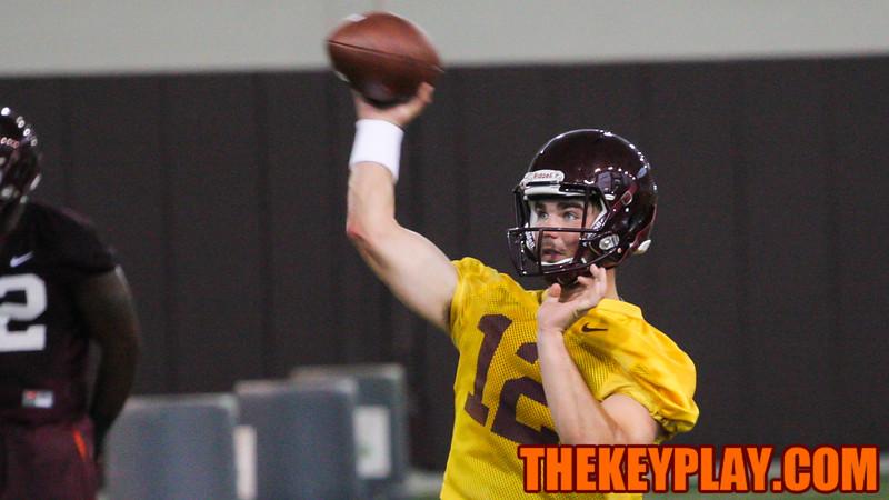 Quarterback Michael Brewer fires off a pass during practice. (Mark Umansky/TheKeyPlay.com)