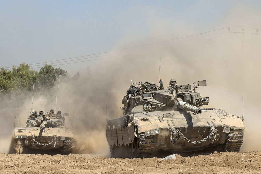 . Israeli Merkava tanks roll to the southern Israeli border with the Gaza Strip, on August 1, 2014. Israeli forces in the southern Gaza Strip are searching for a missing soldier they fear may have been captured by militants at the start of a new ceasefire, the army said. AFP PHOTO / JACK GUEZ/AFP/Getty Images