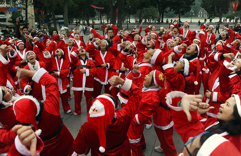 . Members of a local Smiling Yoga club wearing Santa Claus costumes perform at a public park in Hanoi on December 23, 2012. Churches, shops, restaurants and shopping mails are decorated in the Southeast Asian nation with some six million catholics preparing to celebrate Christmas.  HOANG DINH NAM/AFP/Getty Images