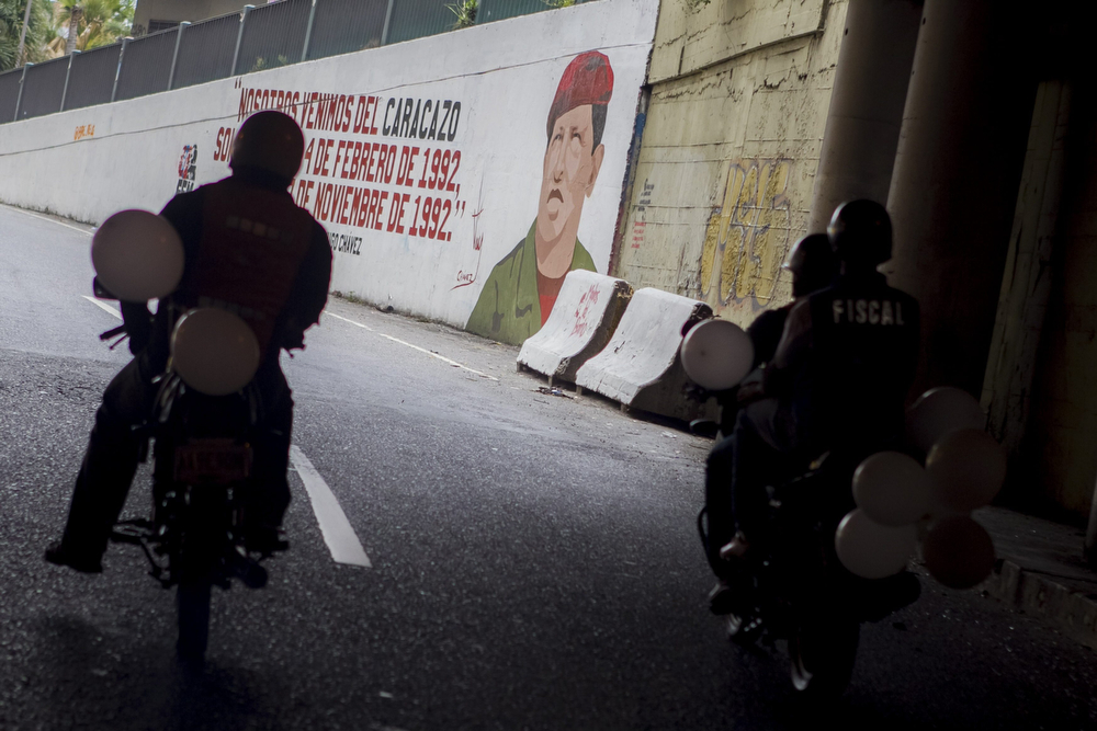 . Motorcyclists take part in a demonstration to support Venezuelan president Nicolas Maduro in Caracas, Venezuela, 24 February 2014. Anti-government activists have been protesting since 12 February, when riots broke out during a peace rally in the Venezuelan capital, killing several people.  (EPA/MIGUEL GUTIERREZ)