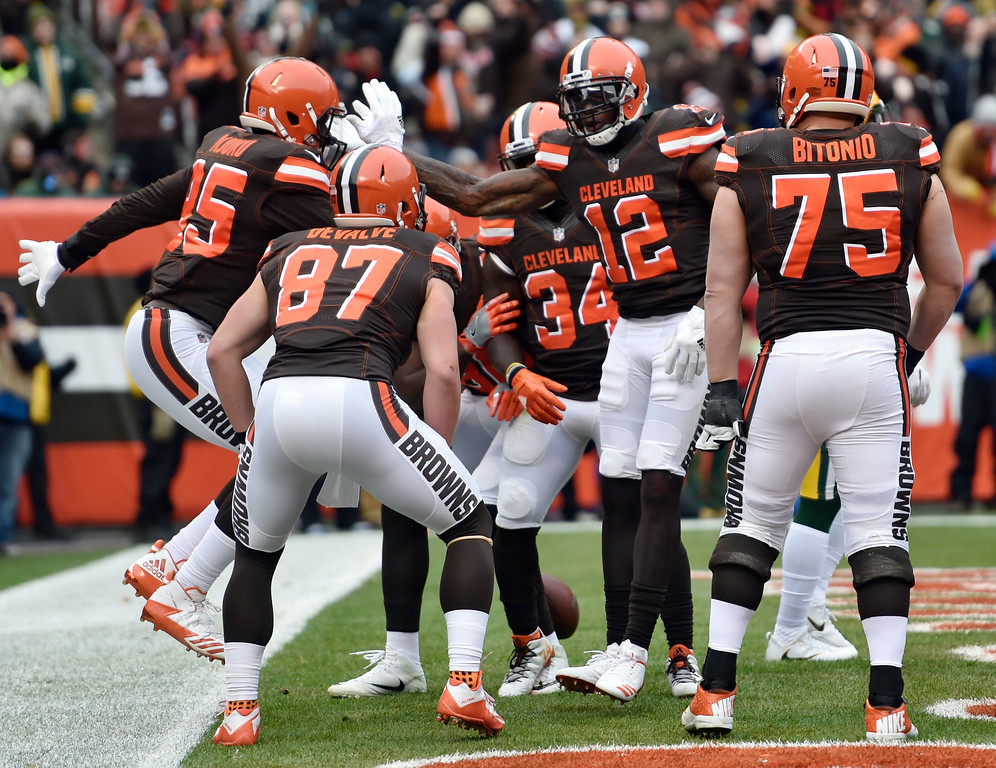 . Cleveland Browns wide receiver Josh Gordon (12) celebrates his 18-yard touchdown pass in the first half of an NFL football game against the Green Bay Packers, Sunday, Dec. 10, 2017, in Cleveland. (AP Photo/David Richard)
