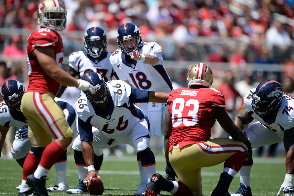 . Denver Broncos quarterback Peyton Manning (18) points out the San Francisco 49ers defense during the first quarter August 17, 2014 at Levi\'s Stadium. (Photo by John Leyba/The Denver Post)