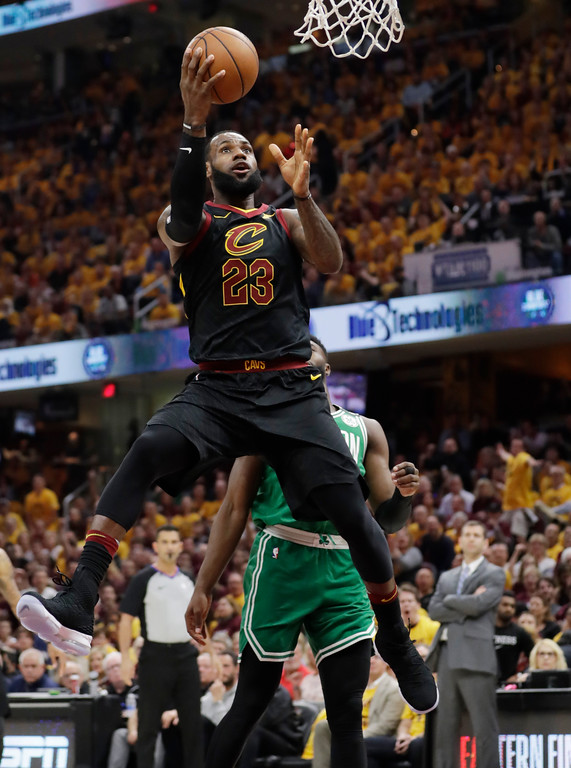 . Cleveland Cavaliers\' LeBron James (23) shoots against the Boston Celtics in the first half of Game 3 of the NBA basketball Eastern Conference finals, Saturday, May 19, 2018, in Cleveland. (AP Photo/Tony Dejak)
