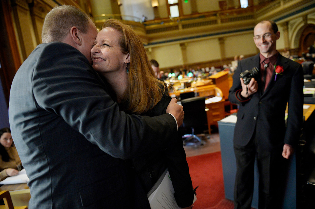 . DENVER, CO. - JANUARY 08: Colorado Senate President Morgan Carroll embraces Darin Raaf during the first day of the new legislative session at the Colorado Capitol in Denver, CO January 08, 2014. Carroll took over the top post in the Senate on Wednesday after President John Morse, a Colorado Springs Democrat, was recalled for his support for tougher gun laws in 2013. Carroll spoke about Raaf and his late partner, David Riffle who died of cancer five days before the Civil Union Act became law.  (Photo By Craig F. Walker / The Denver Post)