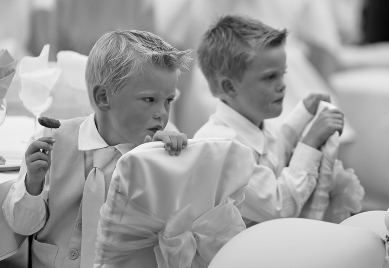 Two young wedding guests,starting the food early
