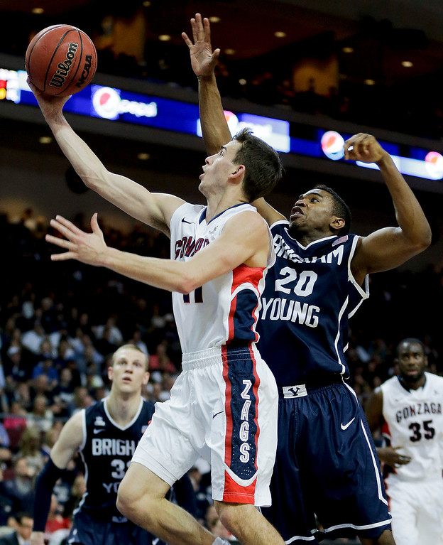 . Gonzaga\'s David Stockton, left, puts up a shot against BYU\'s Anson Winder in the first half of the NCAA West Coast Conference tournament championship college basketball game, Tuesday, March 11, 2014, in Las Vegas. (AP Photo/Julie Jacobson)