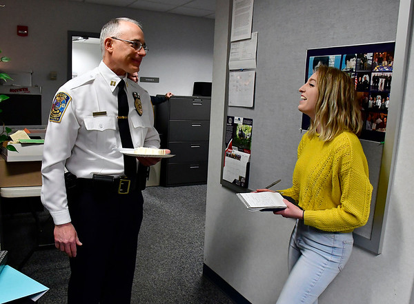2/28/2019 Mike Orazzi | Staff Kayla Murphy talks with retiring Bristol Police Captain Thomas Calvello, Administrative Services Bureau, at police headquarters on Thursday.