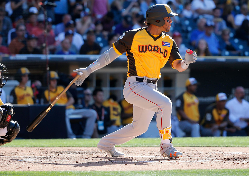 . World Team\'s Yoan Moncada, of the Boston Red Sox, hits against the U.S. Team during the XXX inning of the All-Star Futures baseball game, Sunday, July 10, 2016, in San Diego. (AP Photo/Lenny Ignelzi)
