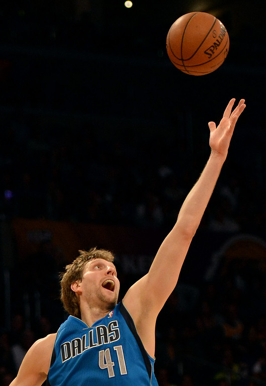 . Dallas Mavericks forward Dirk Nowitzki reaches for a loose ball in the second half during an NBA basketball game against the Los Angeles Lakers in Los Angeles, Calif., on Friday, April 4, 2014. Dallas Mavericks won 107-95.  (Keith Birmingham Pasadena Star-News)
