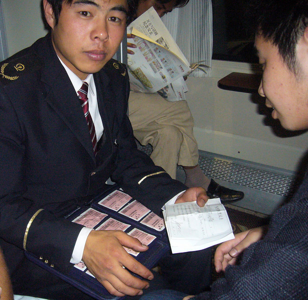 collecting your ticket and checking your documents Qinghai -Beijing to Tibet Railway, Beijing to Lhasa  Oct  2006