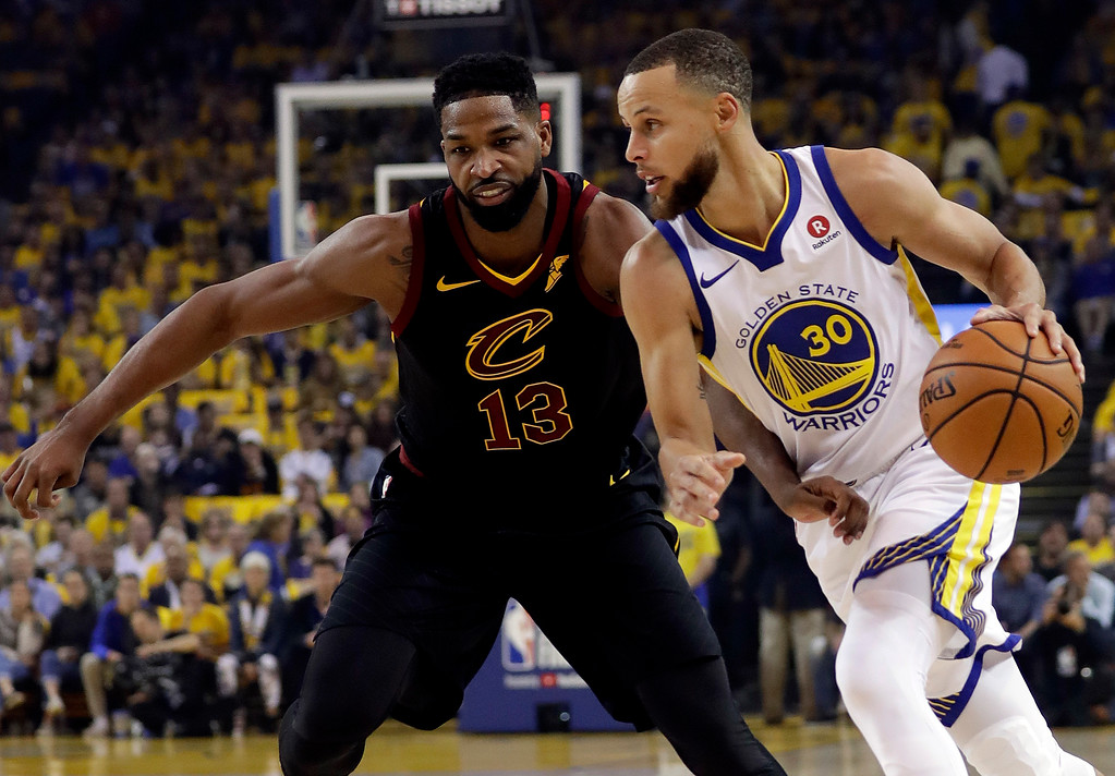 . Golden State Warriors guard Stephen Curry (30) drives against Cleveland Cavaliers center Tristan Thompson (13) during the first half of Game 1 of basketball\'s NBA Finals in Oakland, Calif., Thursday, May 31, 2018. (AP Photo/Marcio Jose Sanchez)