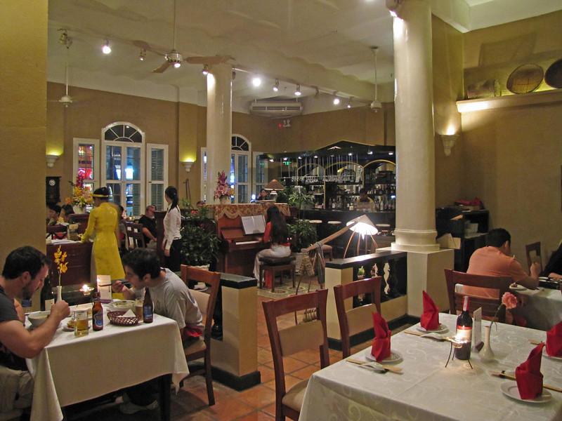 65-Vietnam House restaurant, HCMC. Chivas Regal $6; grilled fish on skewers, $5.