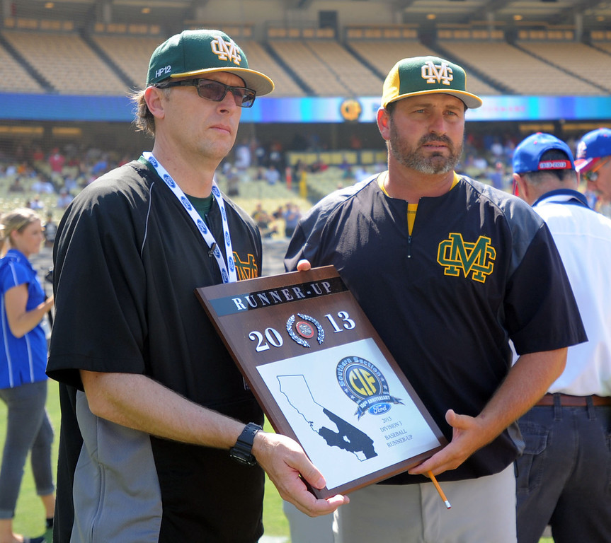 . Mira Costa principal Dr. Ben Dale, left and coach Cassidy Olson, right, hold their runner-up plaque in the CIF-SS Division III championship baseball game Friday at Dodger Stadium. Serra won the title, 8-1. 20130531 Photo by Steve McCrank / Staff Photographer