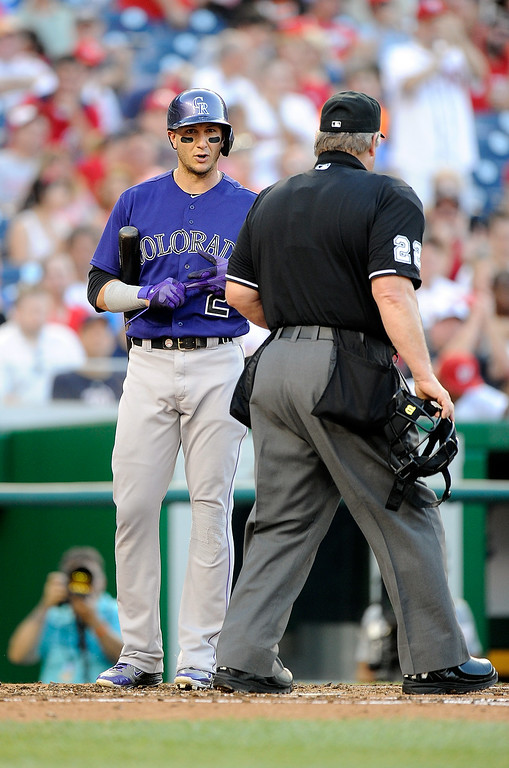 . WASHINGTON, DC - JUNE 30:  Troy Tulowitzki #2 of the Colorado Rockies has words with home plate umpire Joe West after being called out on strikes to end the third inning against the Washington Nationals at Nationals Park on June 30, 2014 in Washington, DC.  (Photo by Greg Fiume/Getty Images)