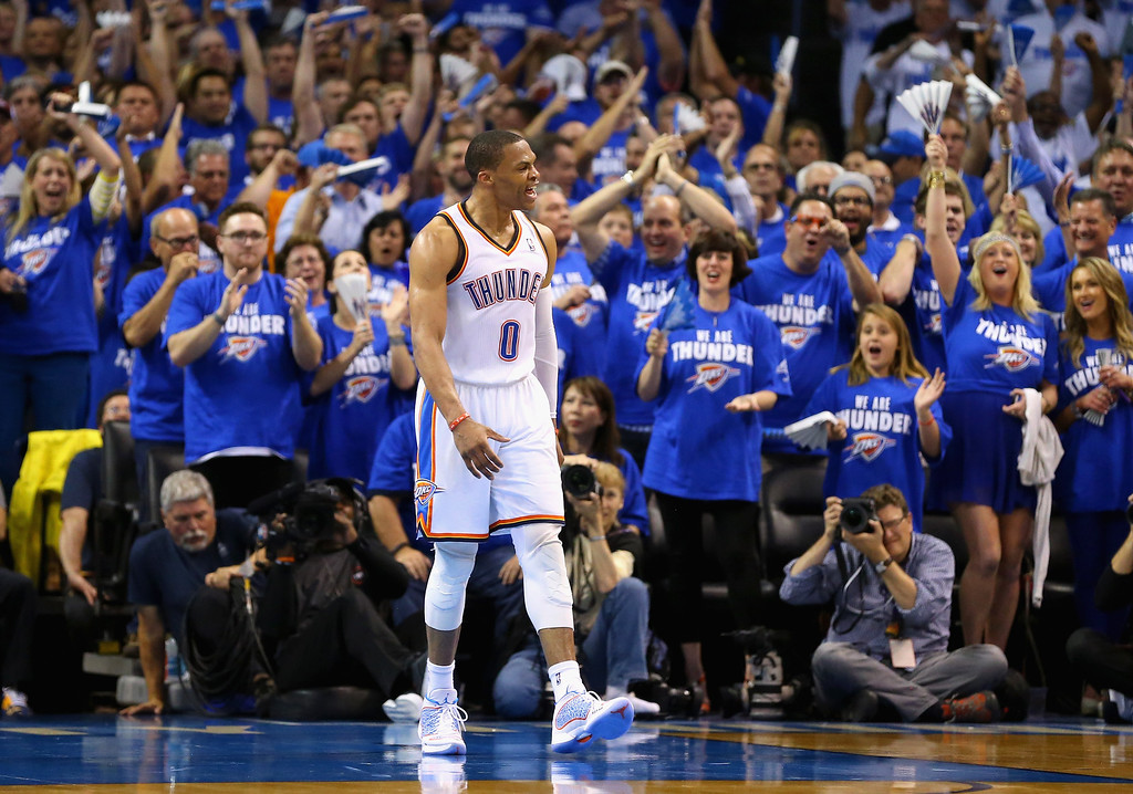 . OKLAHOMA CITY, OK - MAY 27: Russell Westbrook #0 of the Oklahoma City Thunder reacts after a play in the second quarter against the San Antonio Spurs during Game Four of the Western Conference Finals of the 2014 NBA Playoffs at Chesapeake Energy Arena on May 27, 2014 in Oklahoma City, Oklahoma. (Photo by Ronald Martinez/Getty Images)