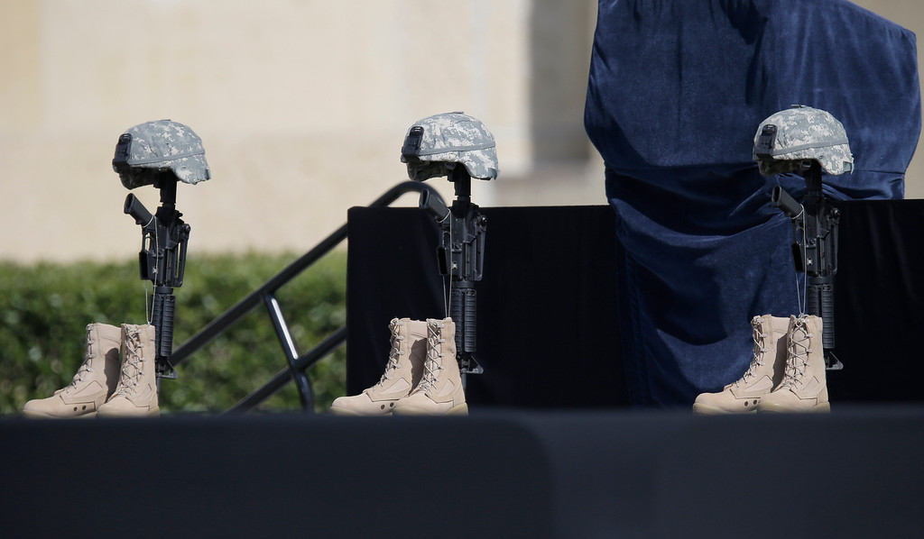 . A military memorial for fallen soldiers is displayed prior to a memorial ceremony for shooting victims that President Barack Obama will attend Wednesday, April 9, 2014, in Fort Hood, Texas. Last week\'s shooting rampage left four dead and more than a dozen injured. (AP Photo/Eric Gay)