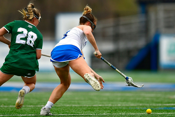 4/20/2019 Mike Orazzi | Staff CCSU Women's Lacrosse's Carson Adelberger (3) and Wagner's Erin Kerstetter (28) in New Britain on Saturday.
