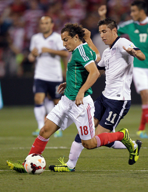 . Mexico\'s Andres Guardado, left, kicks the ball away from United States\' Alejandro Bedoya during the first half of a World Cup qualifying soccer match Tuesday, Sept. 10, 2013, in Columbus, Ohio. (AP Photo/Jay LaPrete)