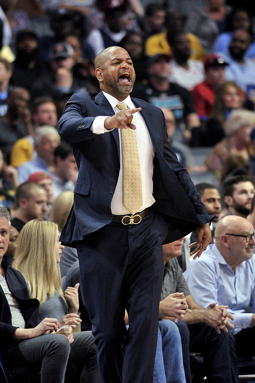 . Memphis Grizzlies interim coach J.B. Bickerstaff calls to players during the first half of an NBA basketball game against the Cleveland Cavaliers on Friday, Feb. 23, 2018, in Memphis, Tenn. (AP Photo/Brandon Dill)