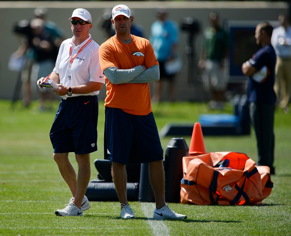 . Denver Broncos head coach John Fox and offensive coordinator Adam Gase look on during practice August 25, 2014 at Dove Valley.(Photo by John Leyba/The Denver Post)