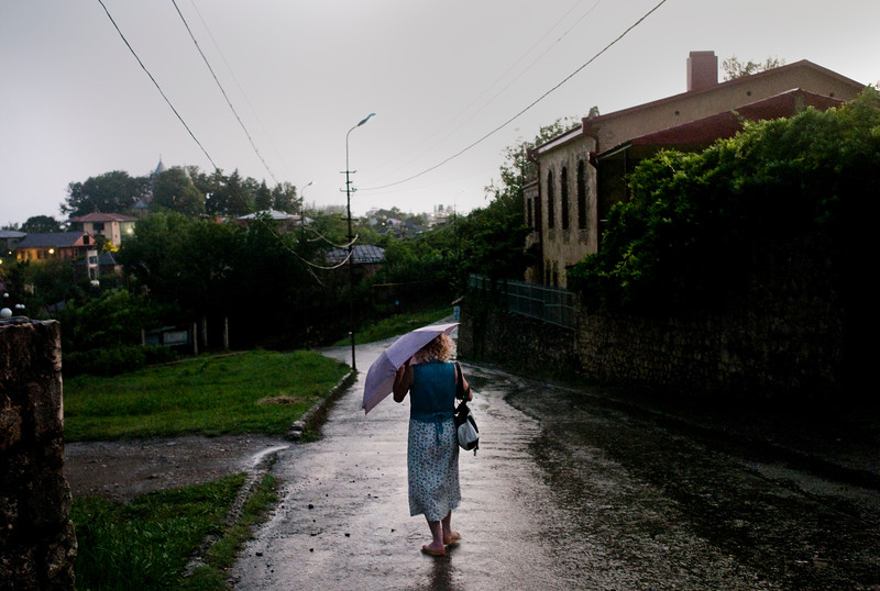 August 2011, Kutaisi,  Georgia:  Women walk from the monastery in the rain   Since 2006 the BTC has allowed Azerbaijan to export its oil to world markets through Georgia and Turkey, thus avoiding Russia.  It has given Azerbaijan a greater sense of independence and a new role for Georgia in Europe's energy security to the annoyance of Russia.  Some blame the BTC for Russia's continued covert involvement in regional latent conflicts especially the South Ossetian crisis which led to the Russia-Georgia war.