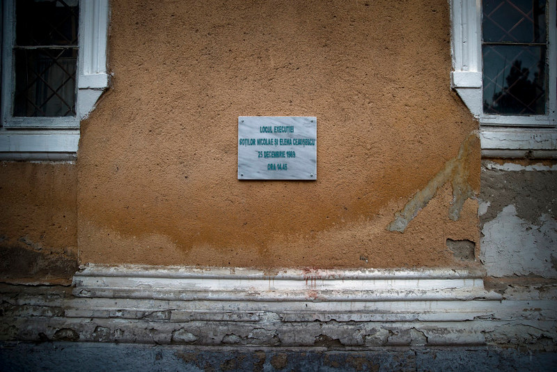 . A picture taken on Dec. 15, 2014 shows a plaque marking the place, at a military garrison in Targoviste, Romania, where communist dictator Nicolae Ceausescu and his wife Elena were executed by firing squad on Dec. 25, 1989.  (AP Photo/Vadim Ghirda)