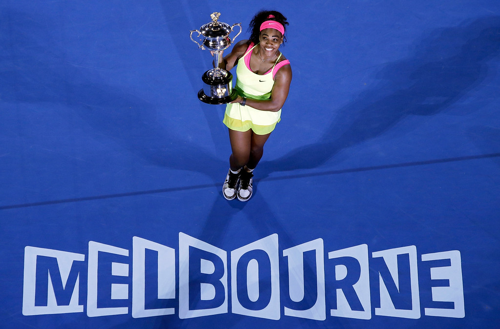 . Serena Williams of the U.S. holds the trophy after defeating Maria Sharapova of Russia in the women\'s singles final at the Australian Open tennis championship in Melbourne, Australia, Saturday, Jan. 31, 2015. (AP Photo/Lee Jin-man)