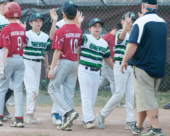 07/09/18 Wesley Bunnell | Staff Edgewood defeated Berlin 13-3 after 5 innings in a District 5 tournament game at Recreation Park in Southington on Monday evening. Edgewood players including Chase Mendela (19).
