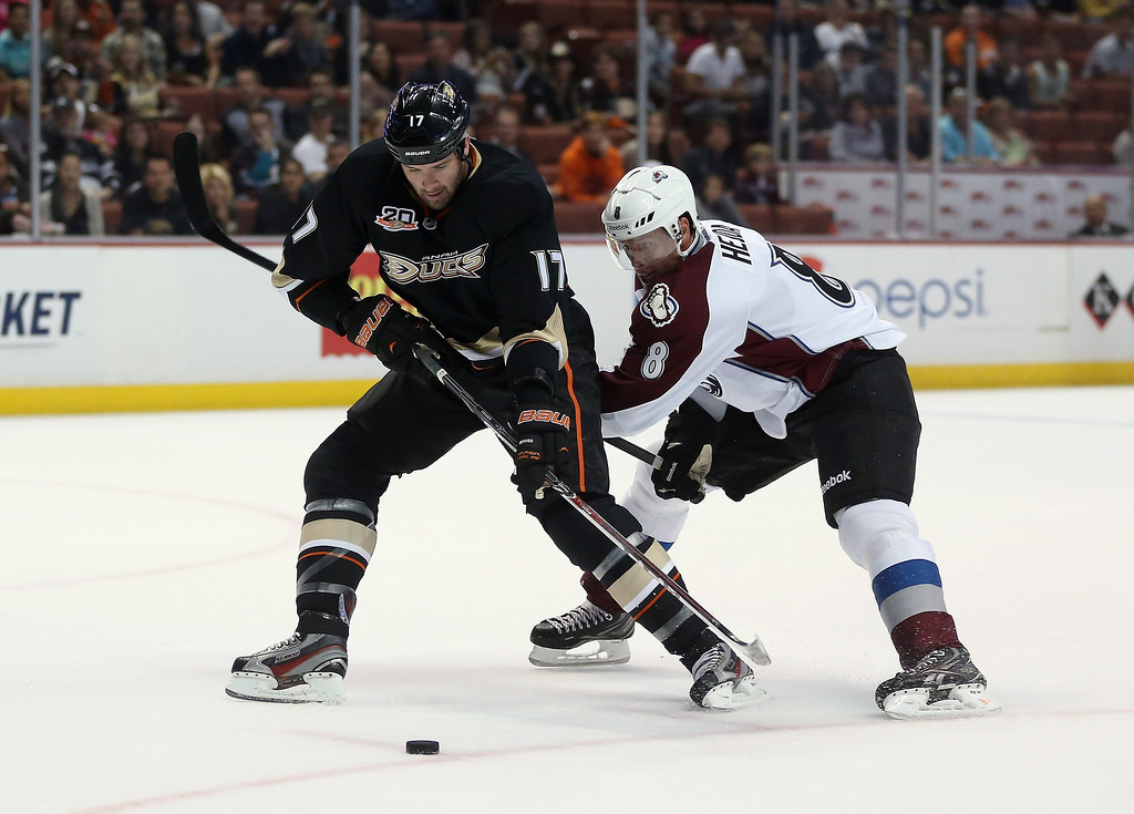 . Dustin Penner #17 of the Anaheim Ducks is pursued by Jan Hejda #8 of the Colorado Avalanche for the puck in the first period at Honda Center on September 22, 2013 in Anaheim, California. The Avalanche defeated the Ducks 2-1. (Photo by Jeff Gross/Getty Images)