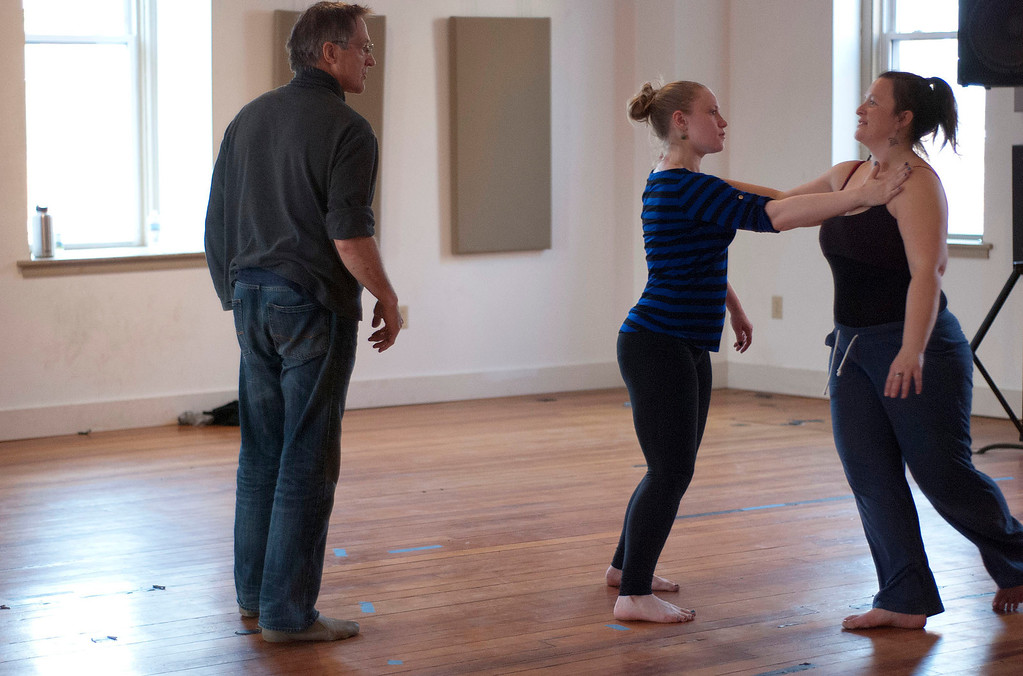 . Kayla Rice/Reformer                                 IBIT (Intrinsic Beauty of Invisible Things) instructor Donlin Foreman gives dancers Genevieve Amarante and Brenda Lynn Siegel help during a rehearsal at their Elliot St. studio in Brattleboro on Tuesday afternoon.