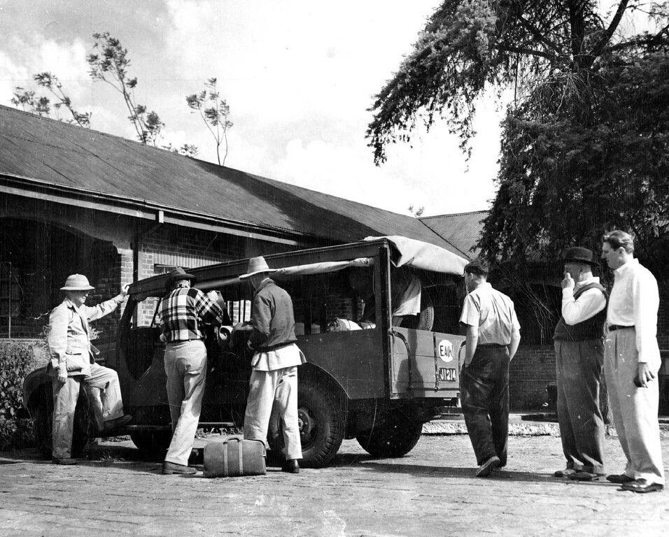 . FEB 20 1950  Americans starting on safari in Africa find it not unlike preparing for a hunting trip back in the States. Loading up of the modern Norfolk hotel in Nairobi are, left to right Ernest Perrine and Lud Rettig, both of Denver; Frank Bowman and Harry Selby, game hunters, and Edward Hurd and his son, Edward Jr., of Detroit.   Credit: Denver Post