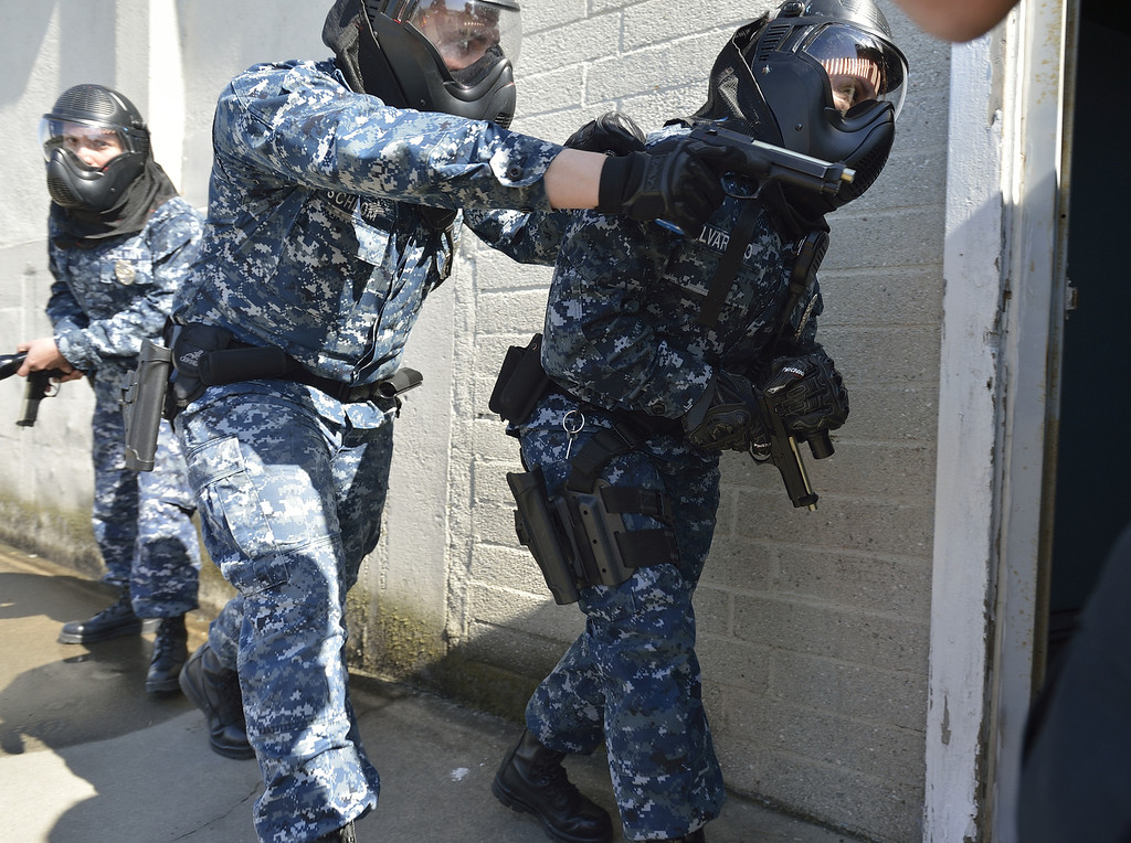 . SEAL BEACH, CALIF. USA -- Sailors assigned to security at the Seal Beach Naval Weapons Station Seal Beach conduct a active-shooter scenario on February 26, 2013.  Photo by Jeff Gritchen / Los Angeles Newspaper Group