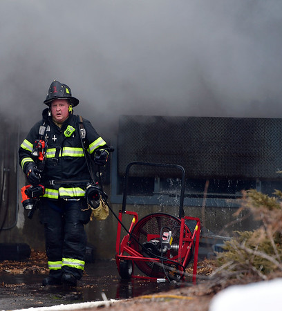 3/1/2019 Mike Orazzi | Staff Bristol firefighters while extinguishing a fire at Arett Sales on James P. Casey Road in Bristol. It took crews several hours to put out the smoky fire that triggered a 2nd alarm that required crews from the Terryville Volunteer Fire Department to assist. The cause is under investigation.