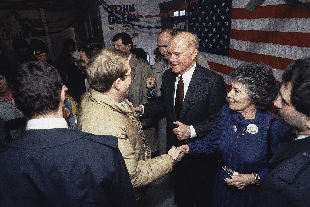 . Sen. John Glenn, D-Ohio, center, and his wife, Annie Glenn, right, greet supporters at Glenns campaign headquarters, Feb. 5, 1984, Keene, N.H. Glenn and other Democratic presidential hopefuls are campaigning in New Hampshire which holds the nations first primary election. (AP Photo/Jim Cole)