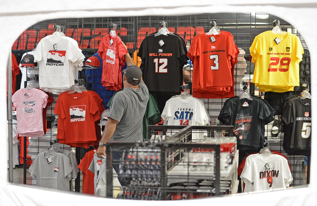 . People shop for race related gear and clothing inside the Lifestyle Expo of the Toyota Grand Prix of Long Beach Friday, April 17, 2015, Long Beach, CA.   Photo by Steve McCrank/Staff Photographer
