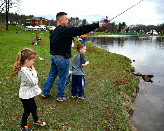 4//13/2019 Mike Orazzi | Staff Mark Roberts while fishing with his children Kaylee,5, and Zack,4 during the city of New Britain's annual fishing derby held at Stanley Quarter Park on Saturday.